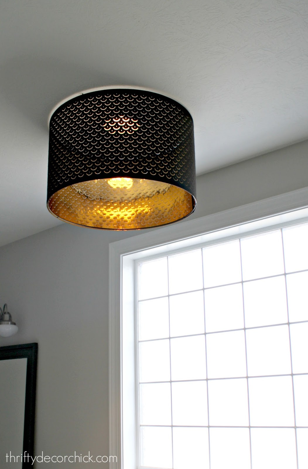 Using a lamp shade as a light fixture from thrifty decor chick large black drum shade flush mount aloadofball Image collections
