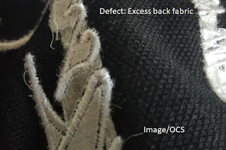 Excess back fabric in embroidery
