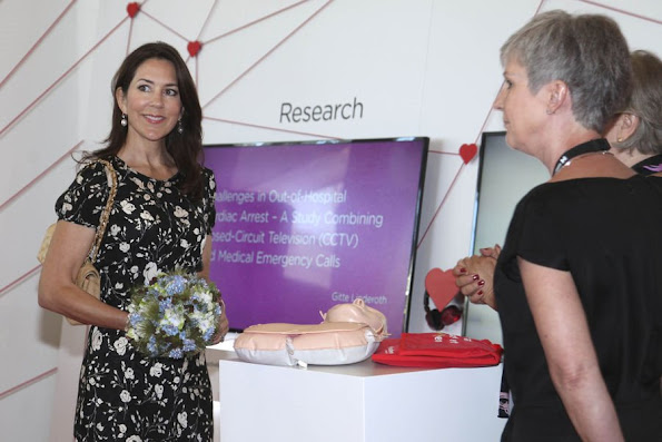Crown Princess Mary attended the opening of Europe Emergency Medical Services 2016 Congress at Tivoli hotel. Princess Mary wears Christian Louboutin shoes, Style Chanel beige Jumbo Classic bag