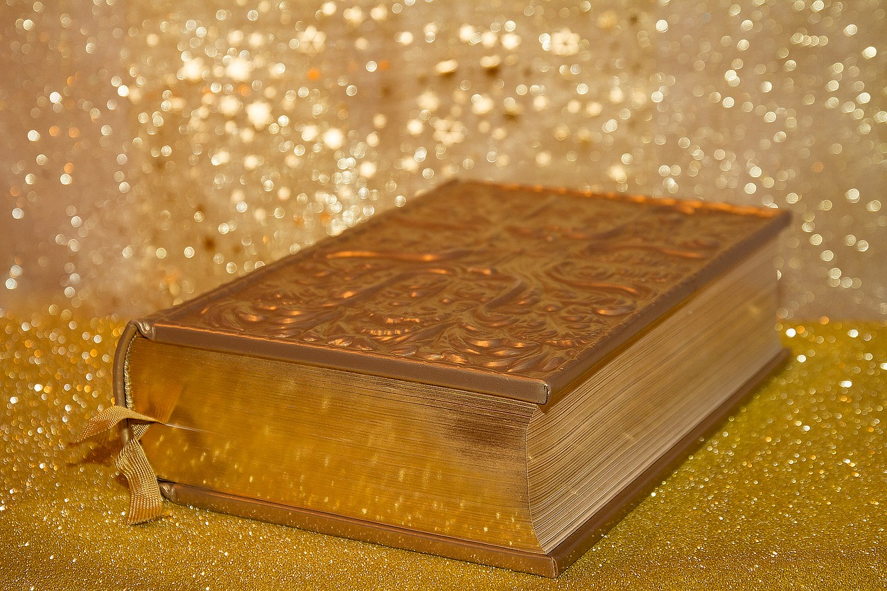 Golden Bible with cross design