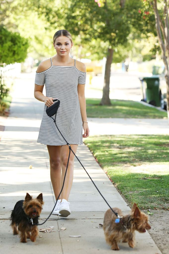 Olivia Holt – Walking Her Dogs in Los Angeles