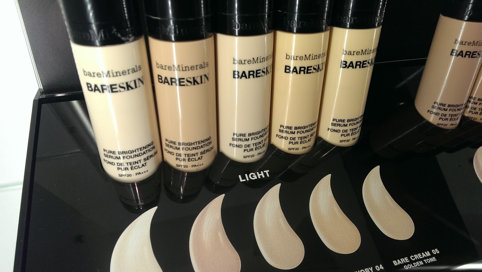 Bottles of Bare Minerals Bare Skin Display