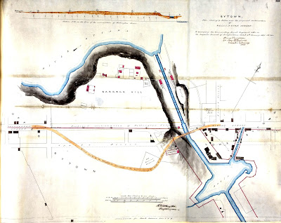Map titled 'BYTOWN. Plan shewing by Yellow lines the proposed continuation of WELLINGTON STREET. To accompany the Commanding Royal Engineer's letter to the Inspector General of Fortifications ,dated 6th January 1851, No 244' It shows Wellington Street near the Rideau Canal from Bank Street to a little west of Sussex and Rideau. Barrack Hill is north of Wellington, and the old road which curves down south of Barrack Hill is drawn (along with the Old Burial Ground). Buildings are outlined between Wellington and Sparks near the canal on the Sparks property. The Wellington Street alignment is drawn out, most of which is obscured by the Barrack Hill and thus does not exist as an actual street, however it is labelled Proposed continuation of Wellington Street. The elevation of this section of Wellington is drawn separately at the top of the map.