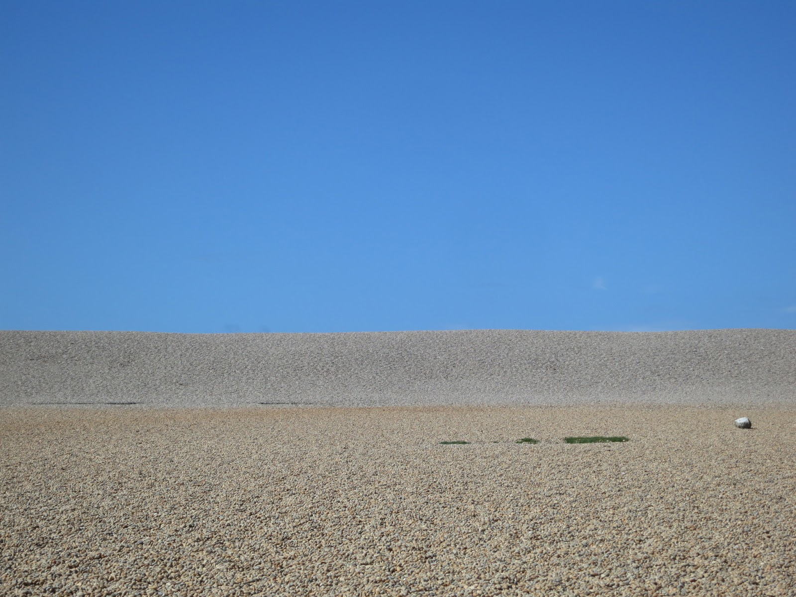 Looking up at Chesil Beach (a huge bank of pebbles) which runs parallel with the road.