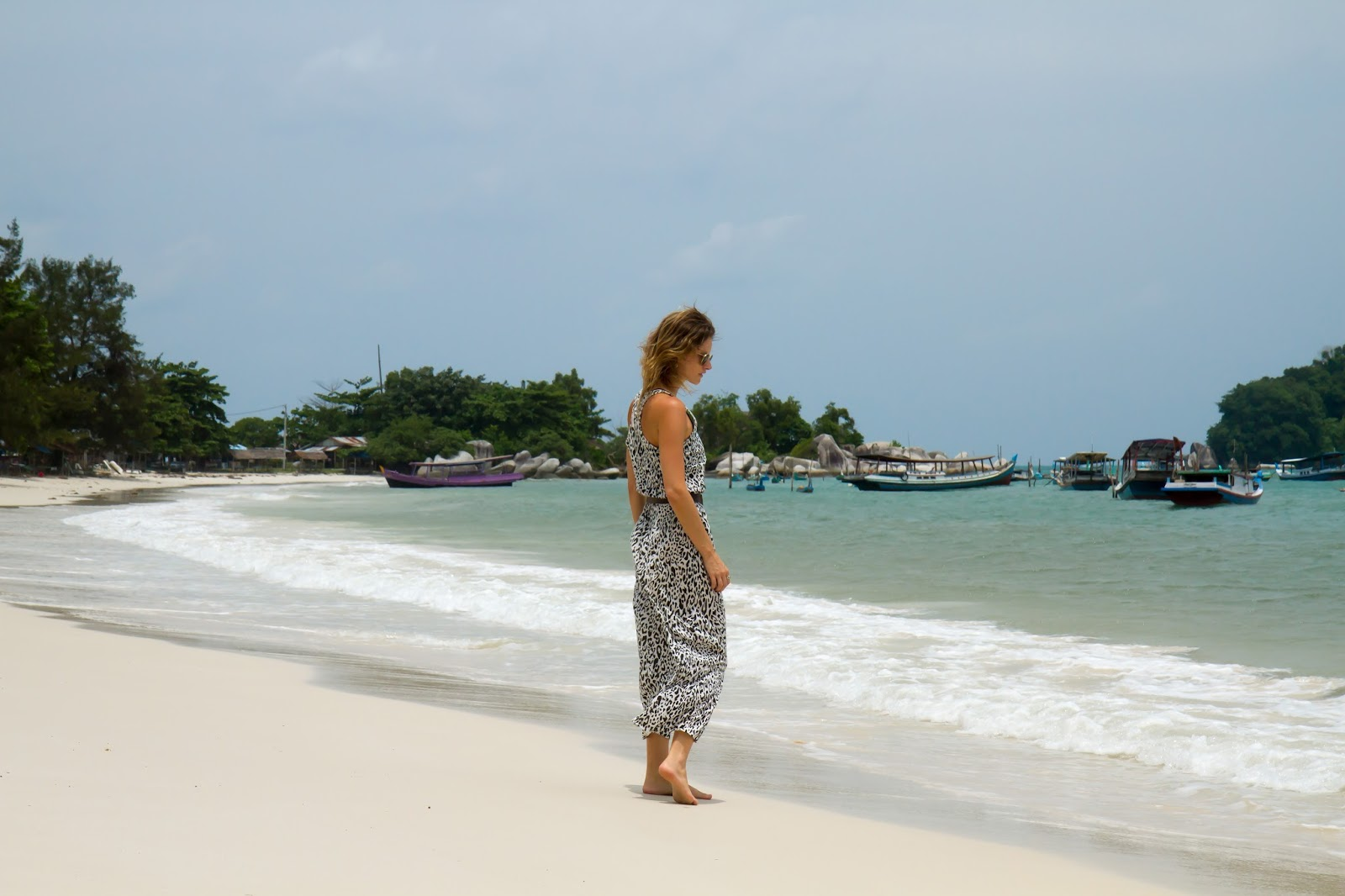 travel blogger, Alison Hutchinson, on a white sandy beach in belitung