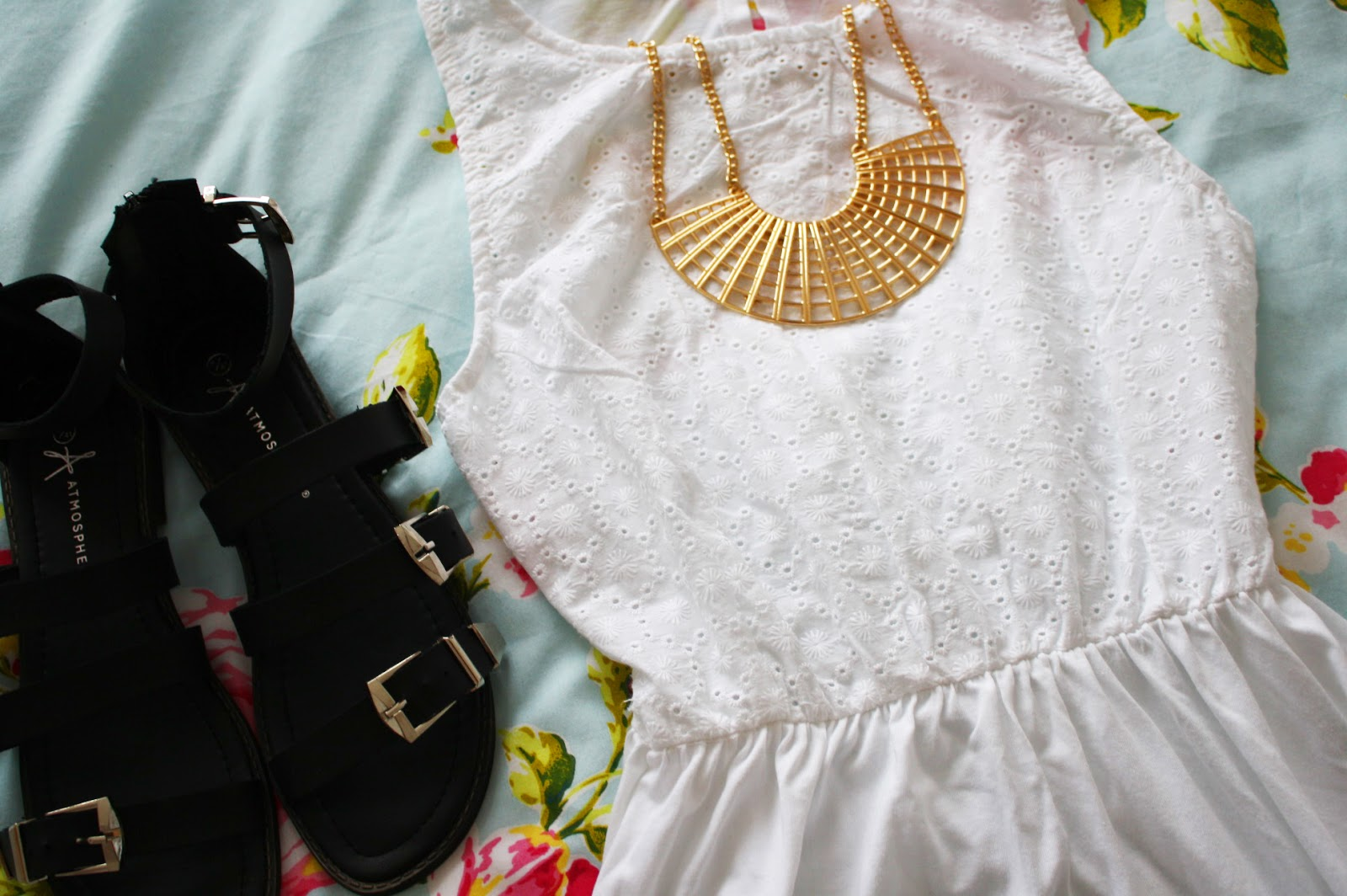 A floaty Primark dress with gold accessories