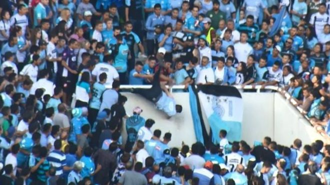 Argentina football fan dies after being pushed from stand