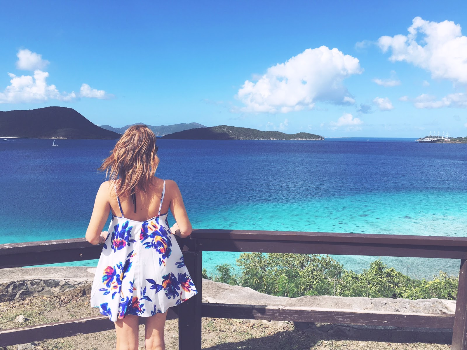 Show Me Your Mumu dress watching sailboats on turquoise Caribbean waters in St John
