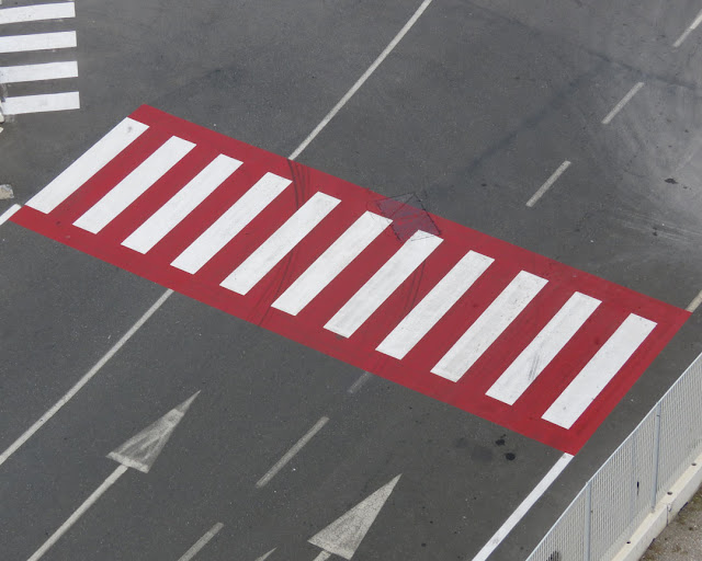 Zebra crossing in red, port of Livorno