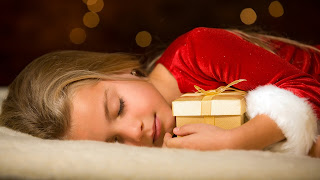 cute-little-girl-sleeping-with-smile-hugging-her-christmas-gift-HD-image.jpg