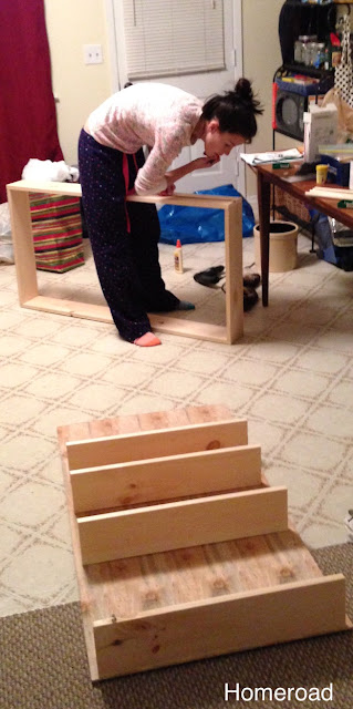 building storage for the kitchen using boards and castors