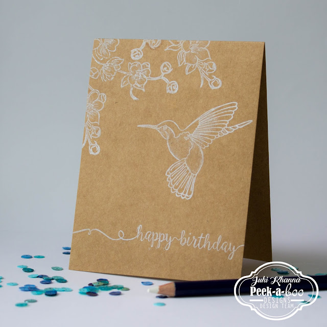 Peek-a-boo designs Humming Bird stamped in white on Kraft Cardstock