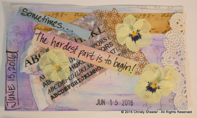 "ICAD June 15, pressed violas, collaged papers and washi tape, and the words, ""Sometimes... the hardest part is to begin!"""