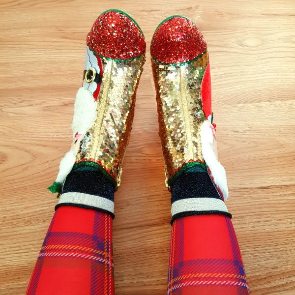 wearing tartan tights, glitter striped socks and gold sequins ankle boots with red glitter and gold stars