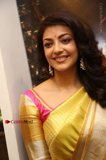 Actress Kajal Agarwal Stills in Golden Silk Saree at Trisha Sesigner Store Launch  0005.jpg