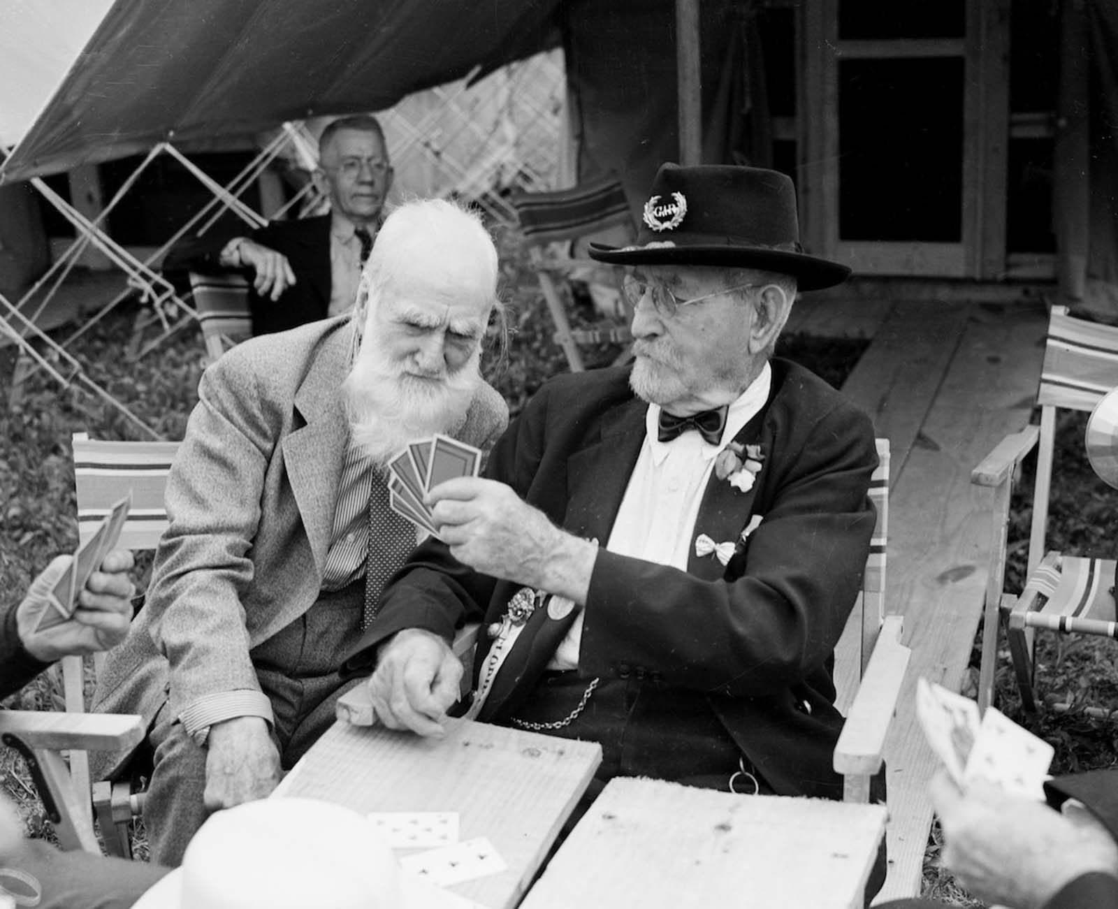 Elderly Civil War veterans playing cards together. 1930.