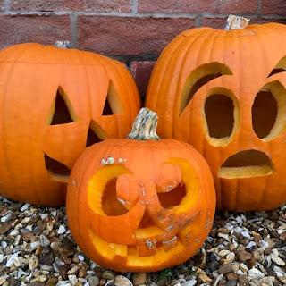 Three carved pumpkins