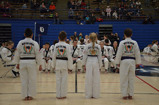 Martial arts kids and adults at at tournament