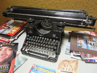 Typewriter with magazines SM Jenkin
