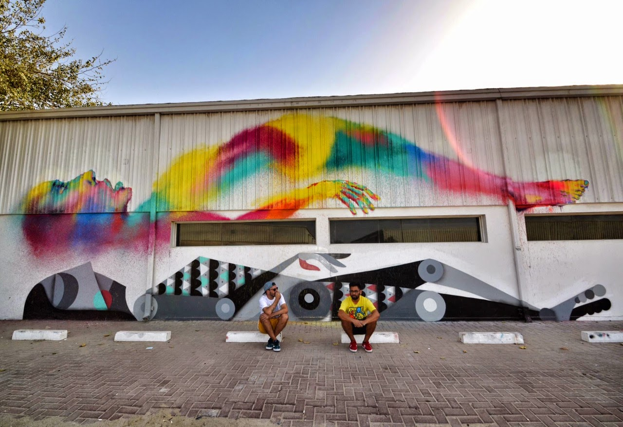 """Ruben Sanchez recently teamed up with Txemy where they took over the city of Al Quoz by storm with a brand new mural entitled """"Astral Travel"""". The newly formed duo dropped this brilliant piece which is featuring each artist's distinctive style and imagery."""