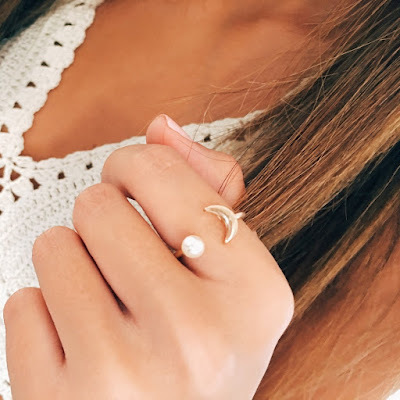 http://stargazejewelry.com/collections/rings/products/moon-pearl-ring?variant=1209146613
