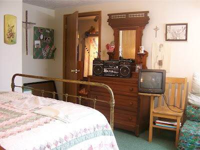 boom box, portable TV, oak school desk chair, Victorian dresser