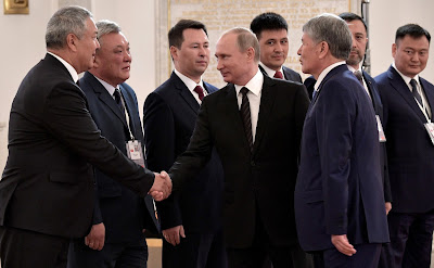 Russian President greeting Kyrgyzstan delegation.