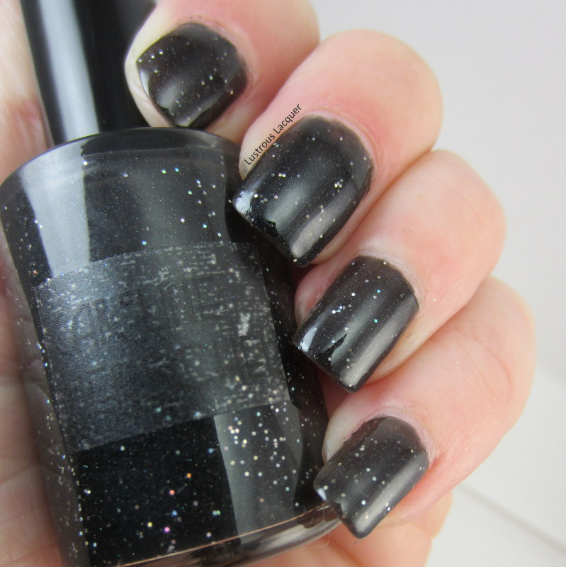 Black-nail-polish-with-holographic-glitter