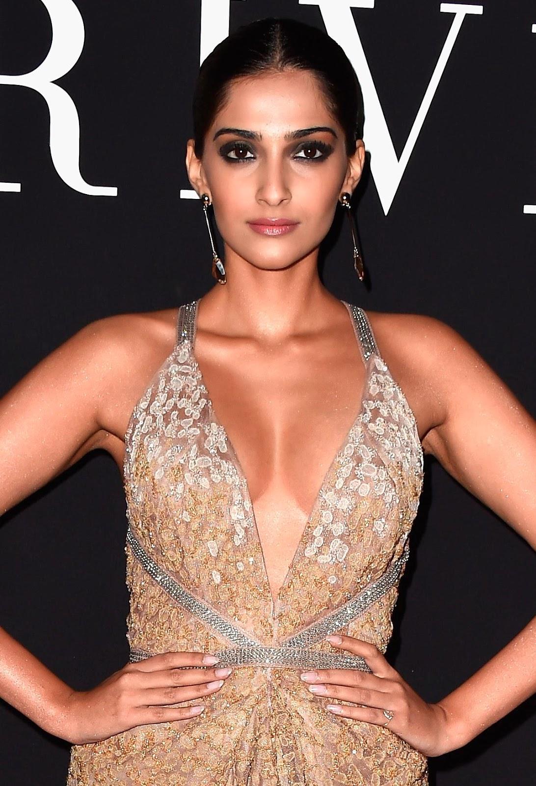 Indian Hot Actress Sonam Kapoor Sizzling Photos In Pink Dress