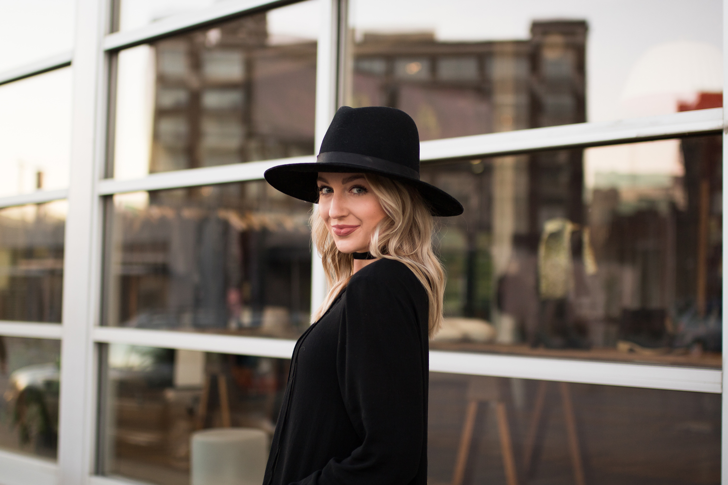 black wide-brim hat