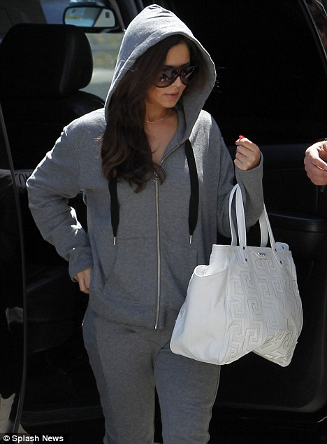 Cheryl Cole makes a fashion faux pas in unflattering grey tracksuit