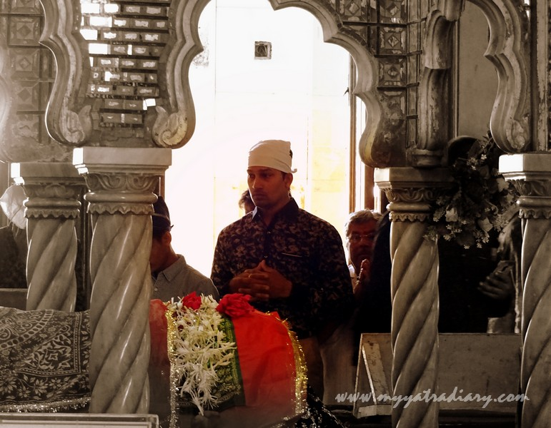 A devout offering dua at the revered mosque of Haji Ali Dargah, Mumbai