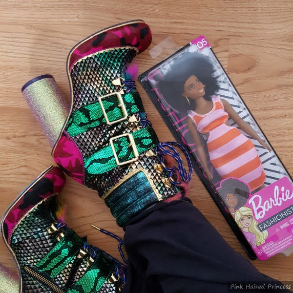 flatlay of multi coloured ankle boots on feet with boxed Barbie Fashionistas doll next to it