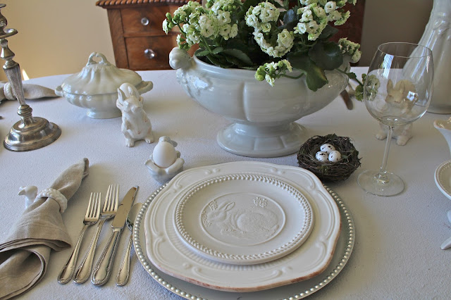 neutral easter tablescape white plates layered over silver charger flax napkin