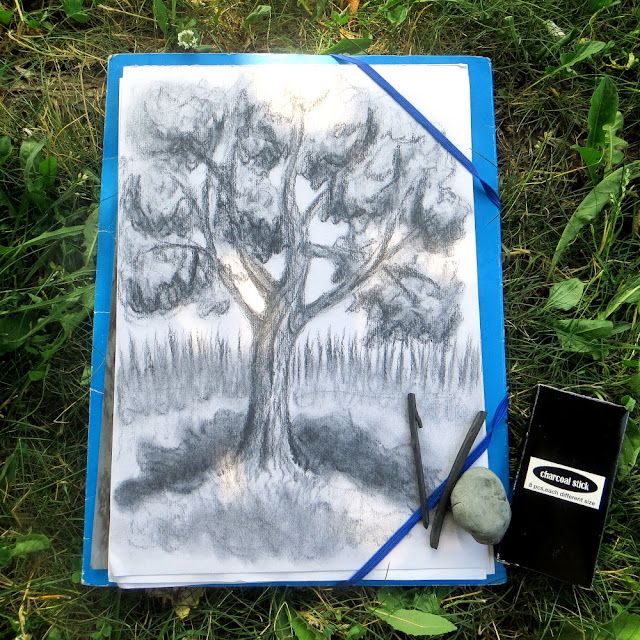 Tree drawing with charcoal sticks and kneaded eraser