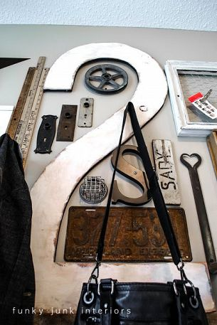 Junk gallery coat hanger wall, via Funky Junk Interiors