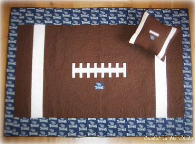 http://www.craftsy.com/pattern/quilting/other/football-quilt/75626?ext=craftlet-pattern