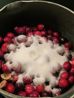 cranberries and sugar in a saucepan