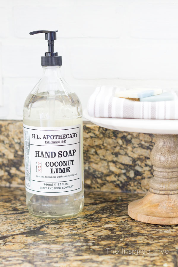 Ideas for farmhouse kitchen decor. Apothecary soap. Use a cake stand for soaps and dish towels.