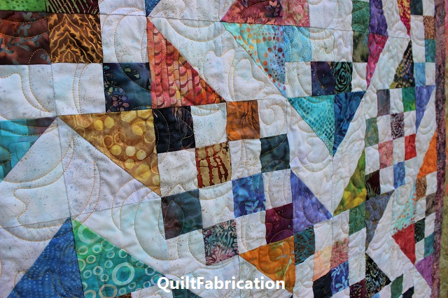 pantograph quilting on Batik Scrap quilt