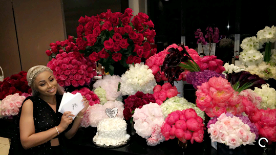 Pregnant Blac Chyna surrounded by flowers on her birthday