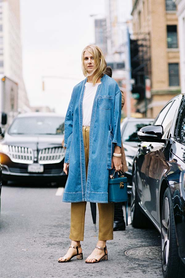 Spring Outfit Idea: denim trench coat, white t-shirt, tan pants, mini blue bag, and metallic block heel sandals