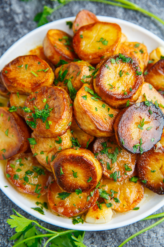 Melting Potatoes Recipe via Closet Cooking - Magical roasted potatoes that are crispy on the outside and melt in your mouth on the inside in a tasty lemon and garlic sauce!