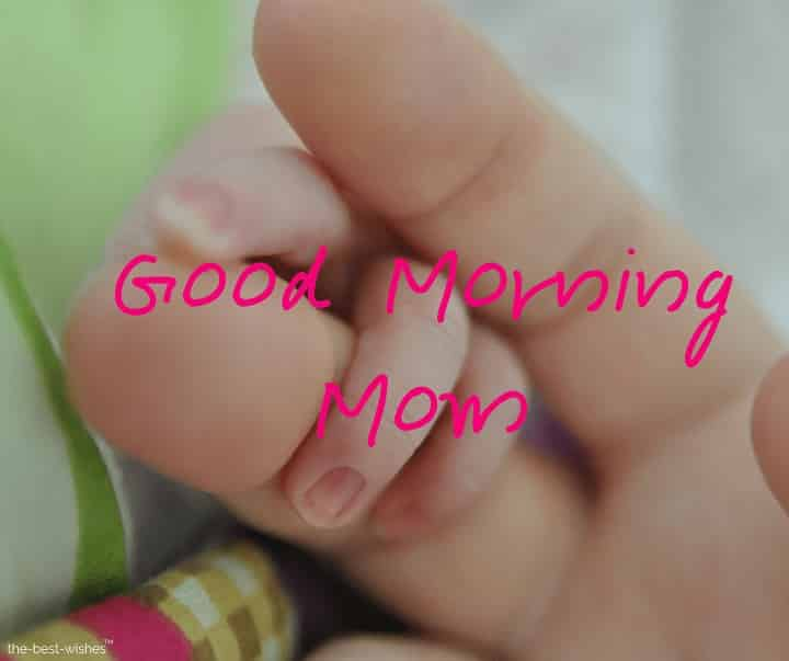 good morning mom baby holding finger