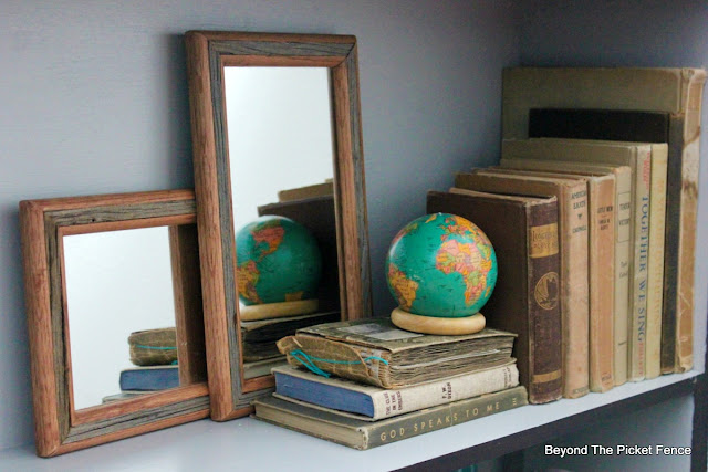 old books and rustic mirrors