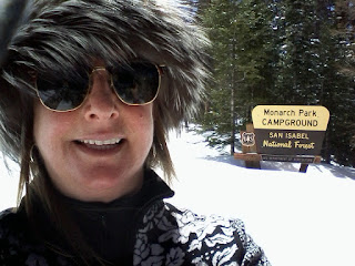 Cross country skiier with a fur mink hat enjoying the spring weather.