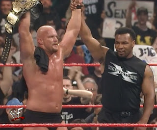 WWE / WWF - Wrestlemania 14 Review  -  Mike Tyson celebrates with new WWF Champion Stone Cold Steve Austin