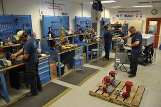 valve automation technicians in workshop