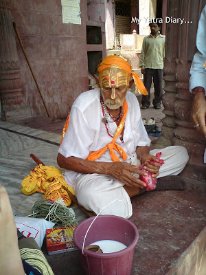 A priest with a tilak on forehead at the Yamuna River Ghat, Mathura