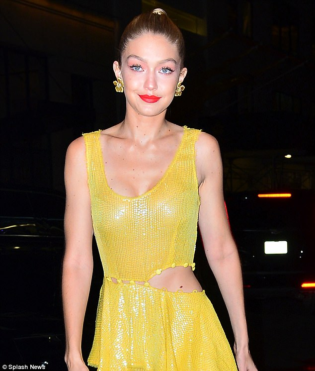 Gigi Hadid flaunts slinky yellow dress at movie premiere in NYC